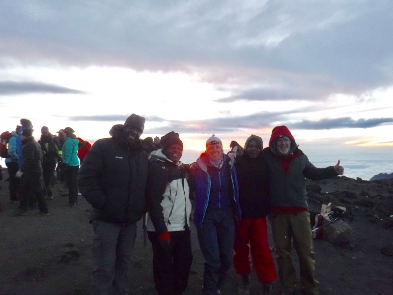 Our happy group at sunrise at 5895m