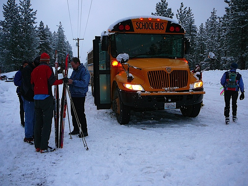 Boarding the bus to ski the Rendezvous Traverse